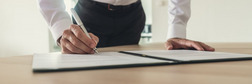 business man signs a contract