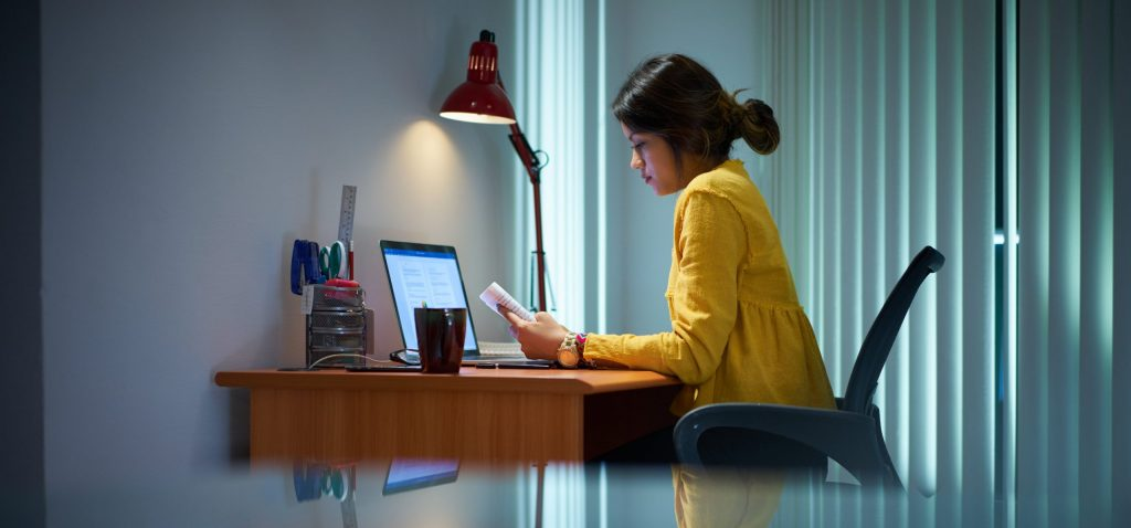 a women works from home due to covid-19 and increases her companys risk of corporate security